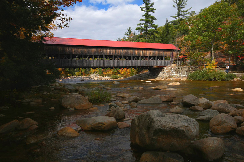 Albany Bridge, White Mountains National Forest, along the Kancamagus Highway. This is on the south bank of the river, looking northwest. Human bridge traffic was brisk at all times, but a little editing left me with just one lady to scale the scene.