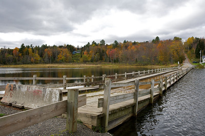 A wooden floating bridge in Vermont.  This is actually part of a state highway, but as is obvious, it is not in working order.