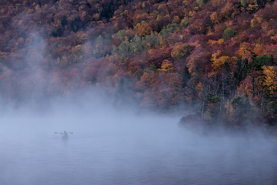 Changing Seasons. A kayaker appeared out of the fog over Echo Lake. HM in Journalism Prints, N4C February 2018.