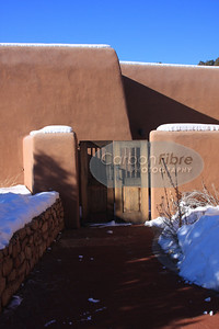 Wall, Gate, and Sky--Pecos, New Mexico