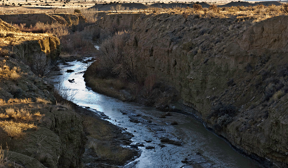 What the water does in NM. Takes the path of least resistance quickly in geological terms.