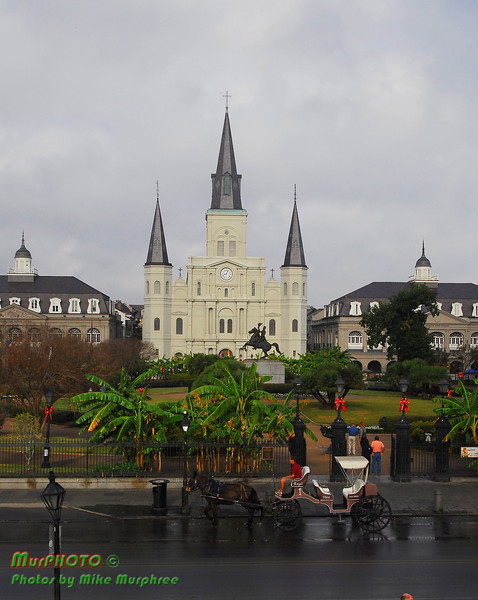 St. Louis Cathedral and Andrew Jackson statue, Jackson Square, New Orleans French Quarter with a horse-drawn carriage