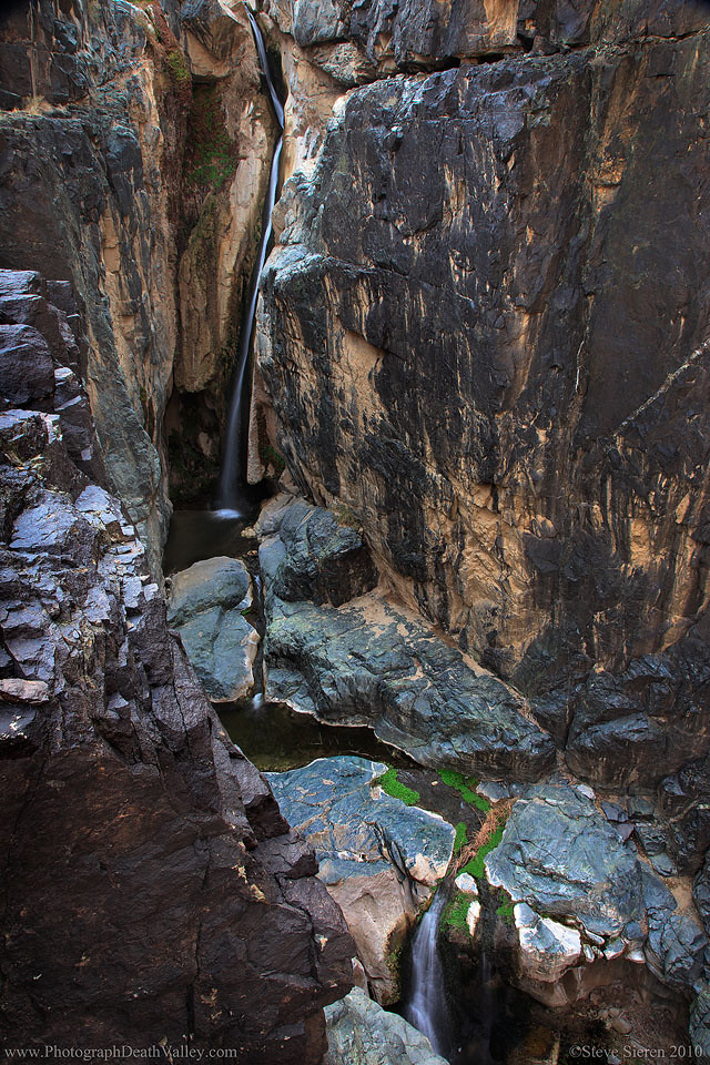 Upper Darwin Falls Death Valley. A majestic canyon 80 ft waterfall slightly hidden from view.