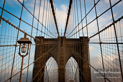 I lived in New York for 3 years and had never walked the Brooklyn Bridge (although I unfortunately *had* walked a couple of the others during times of emergency).  I made my wife and I late for Thanksgiving dinner so I could finally go up and get some shots.  There is no bridge quite like this one in the world.
