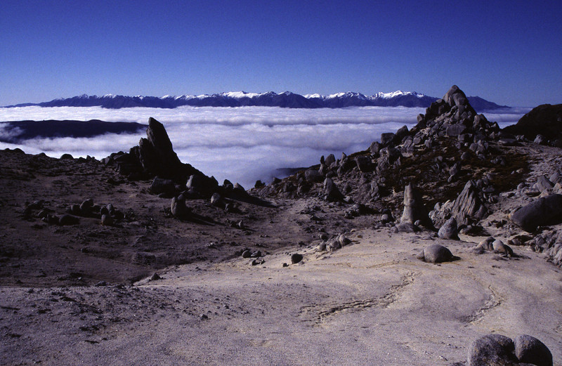 Rock formations on the north ridge of Mt Titiroa. The Takitimu Mountains in the background