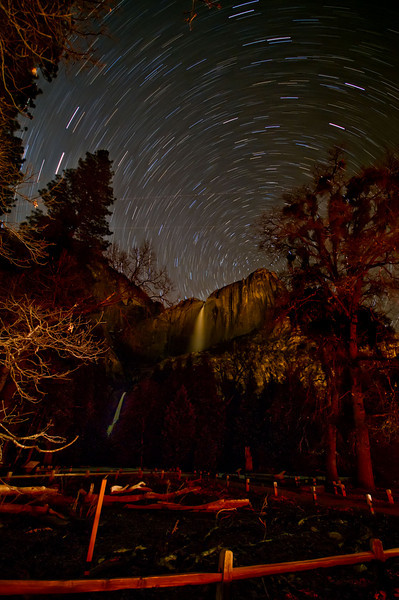"""Star Trails over Yosemite Falls in Winter.  I was one of the only persons in Yosemite Valley when I shot this.  This is a 40 minute exposure.  A ranger finally stopped by to ask what I was doing -- I replied, """"Taking pictures of course!"""""""