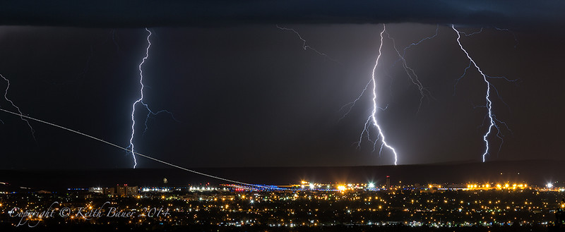 Lightning Storm with a Jet Taking Off