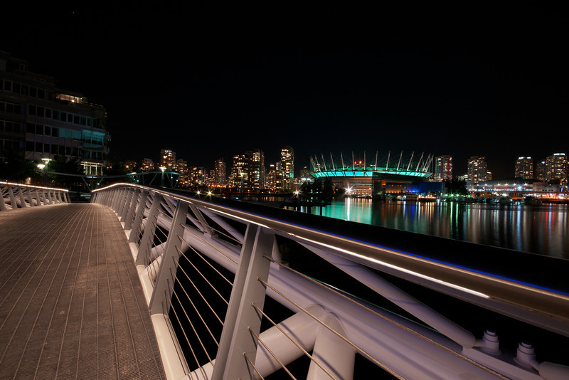 Pedestrian bridge at False Creek at night.