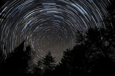 Another star trails experiment, 108 frames,  30 seconds each, stacked. A 29% waxing crescent moon provided some ambient lighting on the spruce and pine trees.