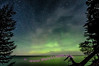 Northern Lights behind moon lit clouds over Lake Superior, Beaver Basin Wilderness area of Pictured Rocks National Lakeshore.