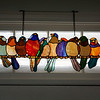 Nor'easter: Bird stained glass in transom with snow behind