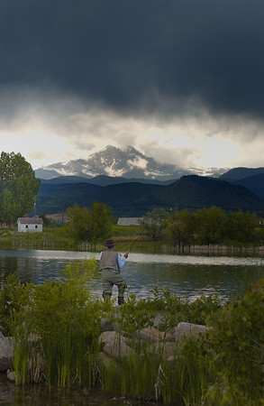 Fishing on Lake McCall, outside Boulder, Colorado with a storm brewing over the Rockies..