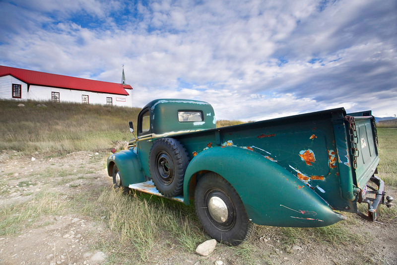 A vintage car and a village Church