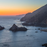 """Big Sur Sunset"" Just a simple coastline shot at sunset along the Northern California Coastline near Big Sur and Julia Pfeiffer Burns State Park near McWay Falls. A simple orange glow with fog in the distance. The steep cliffs drop down quickly to the ragged coastline with a few sea stacks below. It would be fun to be out there in a kayak at sunset instead of up on the hills! Yet another place I want to park my chair on a Friday afternoon!!! — in Big Sur, CA."