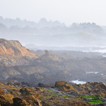 Northern California Coastline at Sunset evening Fog.    The mist and fog coming in at Sunset near Pescadero and south of Half Moon Bay.