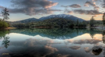 Spectacular sunset over the Oak Bottom arm of Whiskeytown Lake, Whiskeytown National Park, CA.   This is an HDR pano made from 4 horizontal frames.  Each frame is an HDR image created from 3 RAW images using Photomatix Pro.  Pano stitched in Photoshop.