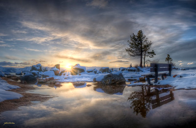 Sunset over Lake Tahoe from Zephyr Cove in Stateline, NV.  This is a panoramic stitch from 5 HDR images, edited using Photomatix pro and Photoshop CS4