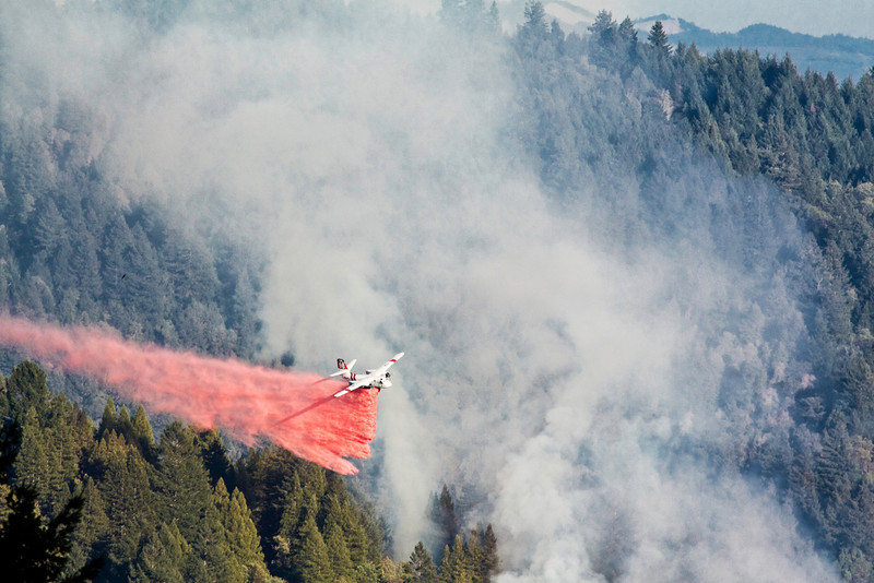 Dropping retardant on forest fire