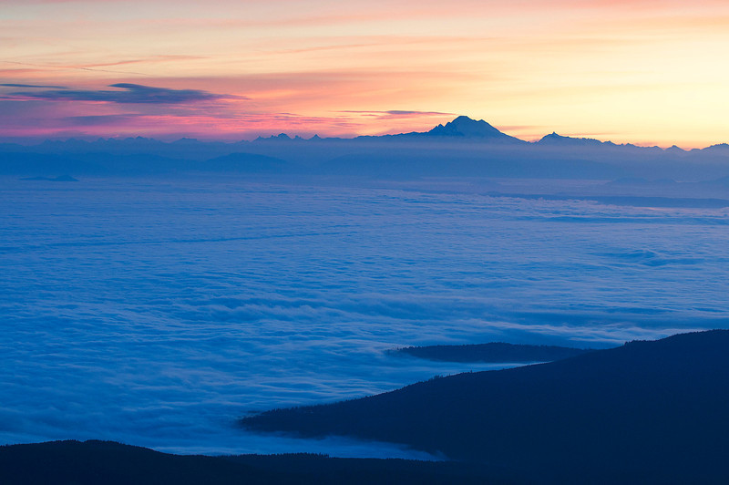 Blue Mountain Sunrise. Above Deer Park Campground at just over 6,000 ft. Looking northeat at Mt. Baker. Strait of Juan De Fuca covered in fog.