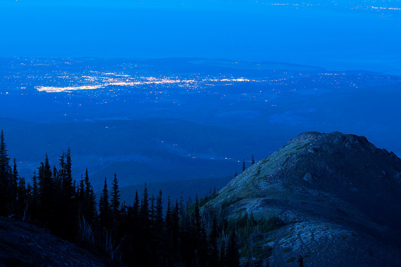 The lights of Sequim, WA below Blue Mountain. The lights of Vancouver Island and Victoria are in the distance. 08.11