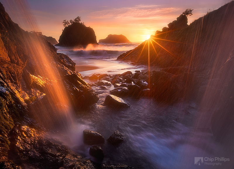 """Ocean Waterfall Oregon Coast.""  Sea Stacks at sunset shot from behind a waterfall on the Oregon Coast."
