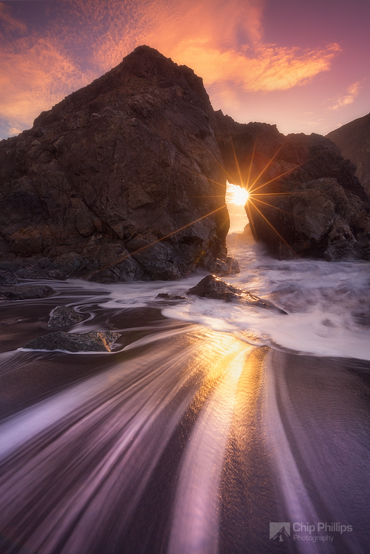 """""""Southern Oregon Coast Sea Arch"""" Only a few days a year, the light shines through this arch.   It isn't accessible at high tide, so it's important for things to line up. On this evening, I was happy to have the conditions that I did."""