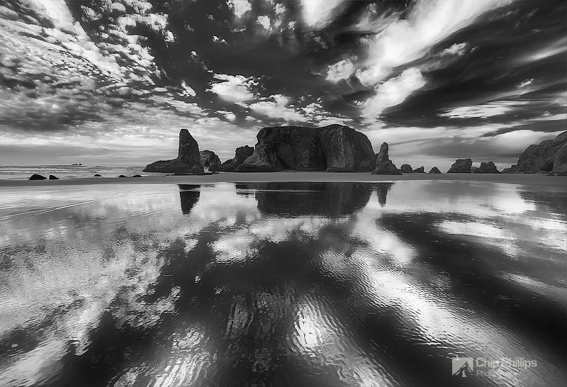 """""""Black and White Cloud Reflections, Bandon Oregon""""  Clouds reflecting in the sand shortly before sunset in Bandon on the Oregon Coast."""