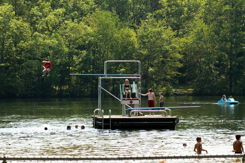 Diving tower and swimmers at Oconee State Park