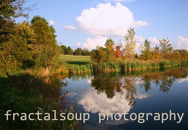 Dramatic Farm Pond Scene with Cloud Reflection