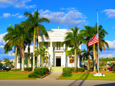 florida, everglades, everglades city, town hall, summer, palm tree, american flag, blue sky,