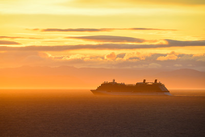 A cruise ship, on its way to Alaska, in the Strait of Juan de Fuca. Vancouver Island across the strait.
