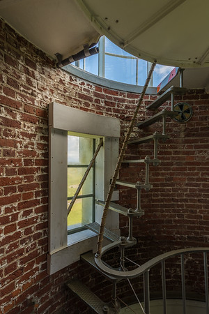 The lighthouse keeper's vigil. The light is at the top of this last flight of stairs/ladder. The lighthouse keepers would spend the night here, below the light, adjusting the draft (note the damper high on the wall near the top of the stairs) and making sure the light burned brightly.
