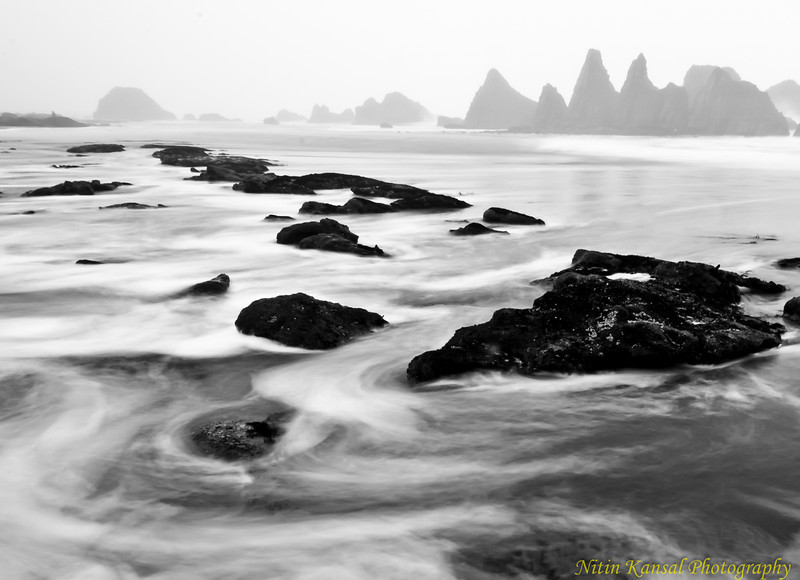 Long Journey!! <br /> <br /> Captured this last week when it was raining and high tide going out. Temperature was near to ~30F and my boots were socked in water, though i didn't feel cold until i was done taking photographs!! I like the way mist come along the rocks.<br /> <br /> Thanks a lot to all of you for comments on my Reflection photograph. Enjoy!!