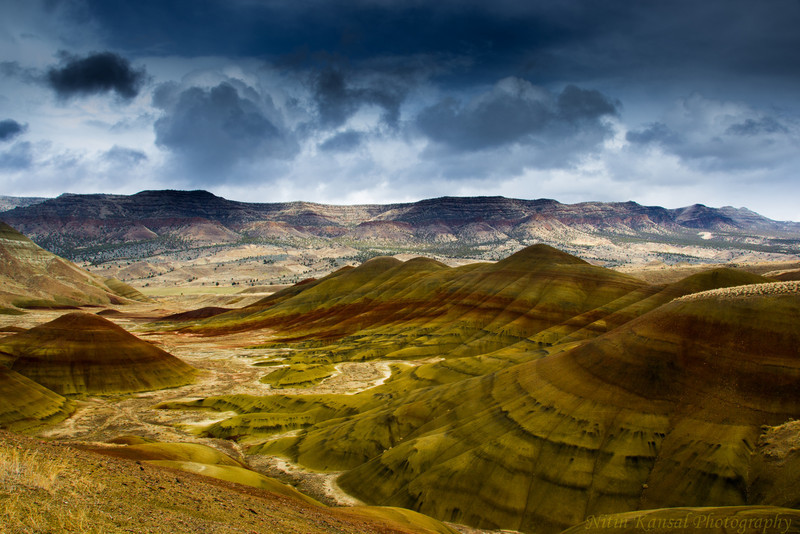 Dramatic clouds and lighting on painted hills.