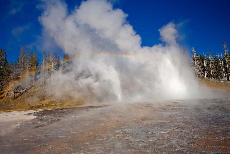 Rainbow over Grand Geyser