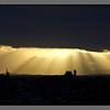 Sunburst behind Bodø skyline
