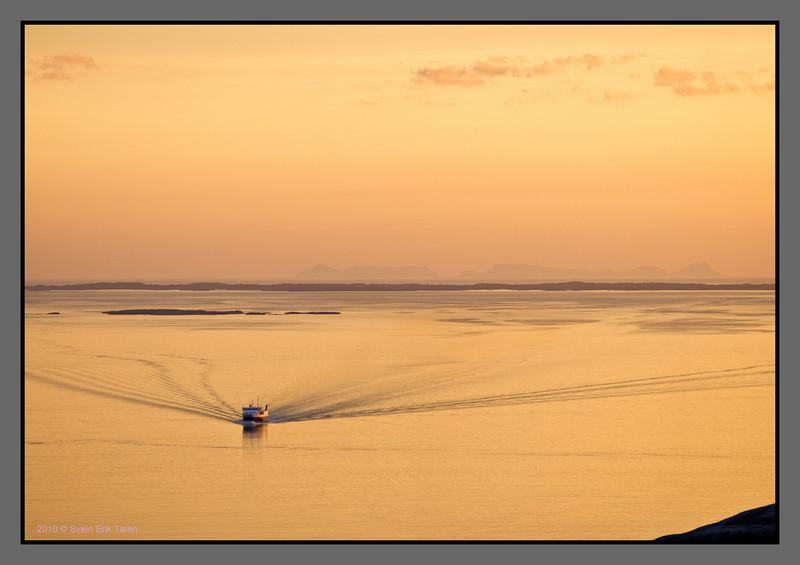 """Ferry """"Bodø"""" crossing the Landegode fjord - Værøy background"""