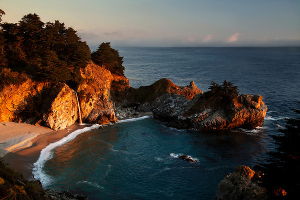 "Last Light on McWay Fall<br /> <br /> McWay Falls is an 80 foot waterfall located in Julia Pfeiffer Burns State Park that flows year-round. Like Alamere Falls, this waterfall is one of only two in the region that are close enough to the ocean to be referred to as ""tide-falls"". It is located on McWay Creek.<br /> <br /> This image was made on August 25,2011 at 7:36 pm as the sun was setting behind the fog bank."