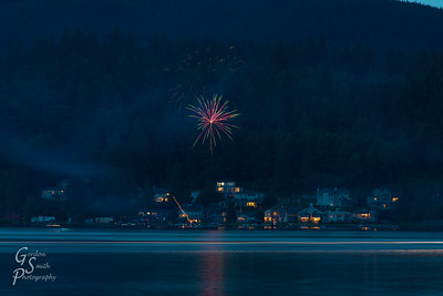 Firework and Passing Boat