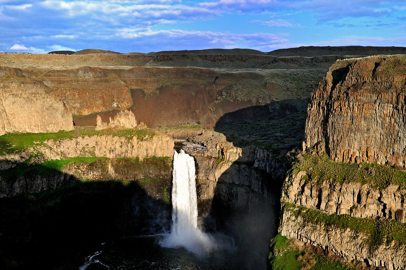 Palouse Falls in late afternoon.  Looks like a shadow of an angel looking at the falls.
