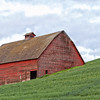 Red barn on hillside
