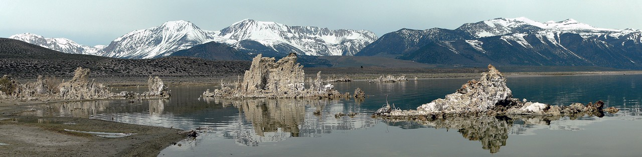 Mono Lake, tufa towers, and the eastern Sierra Nevada, CA. An Osprey's nest is just discernable on top of the formation dead center.