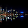 Glassy reflections of the City Of Perth on the Swan River - Western Australia.