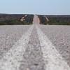 A road to nowhere .... actually a road to Denham, Shark Bay. Western Australia.