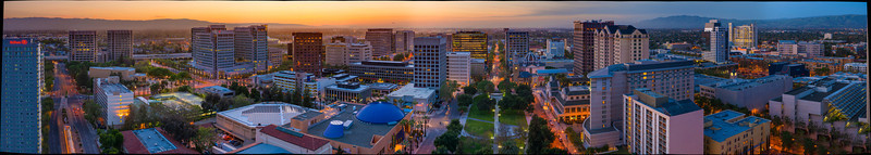San Jose Silicon Valley Skyline Panorama at Dusk. This expansive view showcases many of Silicon Valley's best features in one 180 degree view.  From the Cesar Chavez plaza, the Exploratorium, San Jose Performing Arts Center, The Fairmont Hotel, Capital Club, HP Pavilion and Shark Tank, San Jose City Hall, San Jose Airport, Knight Ridder Building, and the Cathedral Basilica of St. Joseph.  There is airplane caught landing at the San Jose Airport and a trolley on the San Jose Light Rail.   1 - 8 ratio for a 10' by 80' Mural.  This is a Gigapixel image composed of 16 images * 3 exposures each @ 36 Megapixels.
