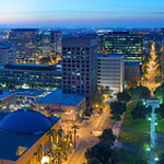 San Jose Night Skyline at Dusk.   San Jose Silicon Valley Skyline Panorama at Dusk. Captured from the Concierge Lounge balcony of the San Jose Marriott this expansive view showcases many of Silicon Valley's best features in one 180 degree view. From the Cesar Chavez plaza, the Exploratorium, San Jose Performing Arts Center, The Fairmont Hotel, Capital Club, HP Pavilion and Shark Tank, San Jose City Hall, San Jose Airport, Knight Ridder Building, and the Cathedral Basilica of St. Joseph. There is airplane caught landing at the San Jose Airport and a trolley on the San Jose Light Rail. 1 - 8 ratio for a 10' by 80' Mural. This is a Gigapixel image composed of 16 images * 3 exposures each @ 36 Megapixels