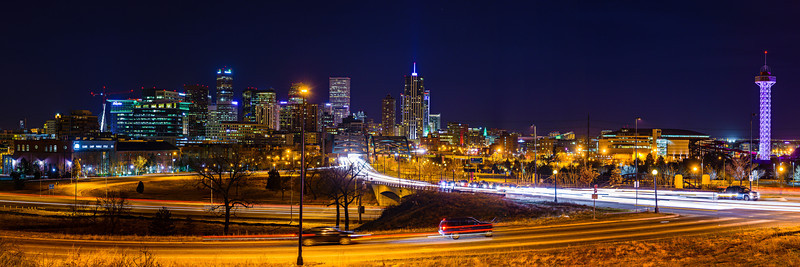 """Denver Skyline at Night"" I was out in Denver last week and headed out to grab some shots of the skyline at night! I'll have to grab a sunrise there sometime and get the mountains in the background. Lots of lights and cool buildings glowing in the night. The hockey game at the Pepsi Center area (where the Denver Nuggets, Colorado Avalanche and Colorado Mammoth play) had just let out and there was a steady stream of cars coming towards me. Definitely a nice city that I will have to explore more next time."
