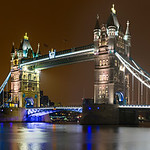 """Tower Bridge at Night""  London, England, United Kingdom. This summer I had a business trip to London and we stayed just down the way from the Tower Bridge. I headed out to capture some shots at night as the bridge is nicely lit at night and the reflections on the River Thames looked fantastic! Another one of those fantastic places to visit!  <br /> <br /> I created this image with 6 Nikon D800 images and the Nikon 24-70 f/2.8 lens, f/16, 30 second exposures, ISO 100.  Processed in Lightroom 4 and exported as 16 bit TIFFs.  The Panorama was stitched in Autopano Giga 3.0 from and cropped to a 1:2 panorama.  Nothing better than lots of pixels to make ginormous panoramas!!  Can't wait to print this one.   Night photography in London is fun and can't wait to go back!   One note- don't wait too late as they turn off the lights at the Tower of London, Majesty's Royal Palace and Fortress, around 11pm!  I was hoping to include that lit up but missed it!"