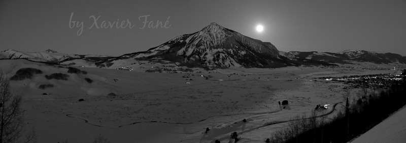 Full moon rising above Crested Butte Mountain and the valley.