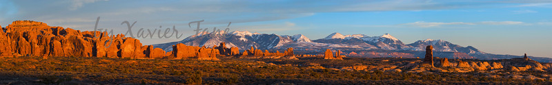 The La Sal Mountains seen from Arches National Park at sunset.